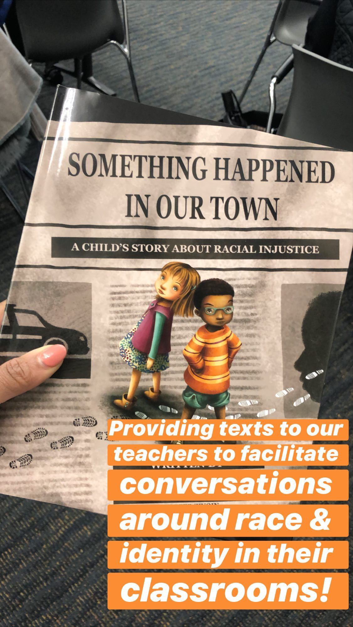 image of the book cover from the text: Something happened in our town. A child's story about racial injustice. Text on image says: Providing texts to our teachers to facilitate conversations around race and identity in their classrooms!